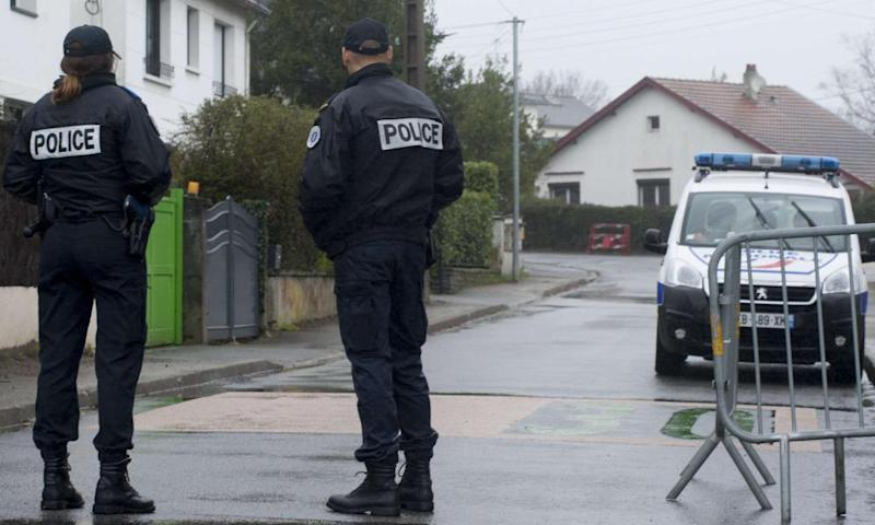French police officers block access to the street in Orvault where the Troadecs were killed.