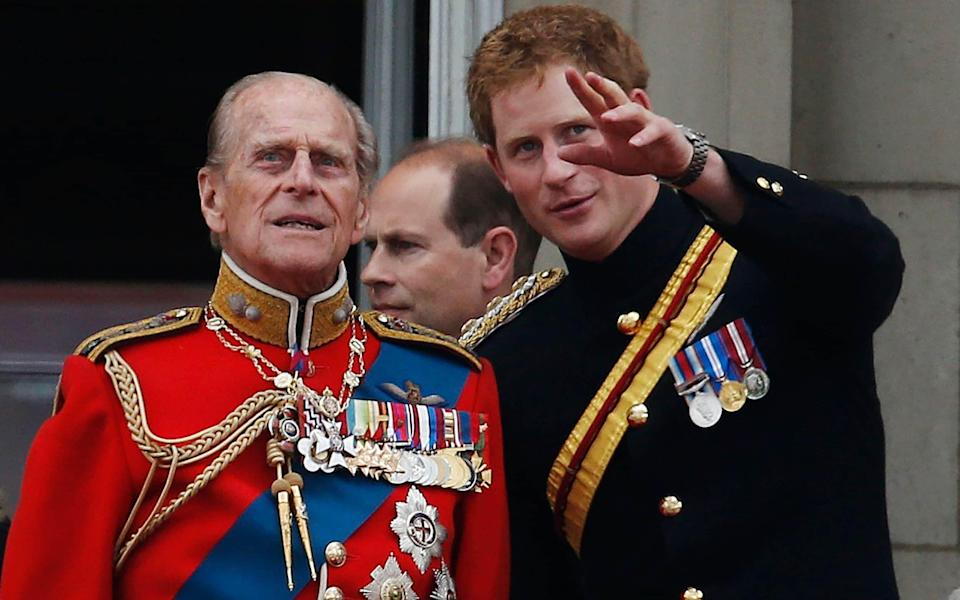 Prince Harry, pictured with Prince Philip on the balcony of Buckingham Palace in June 2014 -  Lefteris Pitarakis/AP