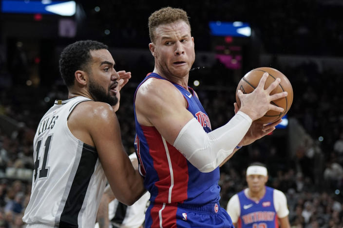 Detroit Pistons' Blake Griffin, right, drives against San Antonio Spurs' Trey Lyles during the first half of an NBA basketball game Saturday, Dec. 28, 2019, in San Antonio. (AP Photo/Darren Abate)