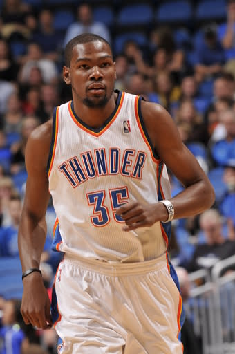 ORLANDO, FL - MARCH 22: Kevin Durant #21 of the Oklahoma City Thunder runs up the floor against the Orlando Magic during the game on March 22, 2013 at Amway Center in Orlando, Florida. (Photo by Fernando Medina/NBAE via Getty Images)