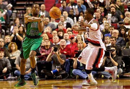 Boston Celtics shooting guard Jordan Crawford (27) passes away from Portland Trail Blazers shooting guard Wesley Matthews (2) at the Moda Center. Craig Mitchelldyer-USA TODAY Sports