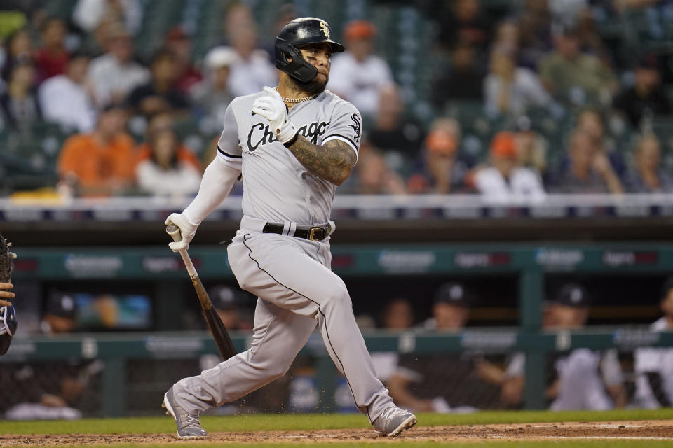 Chicago White Sox's Yoan Moncada grounds into a force out that scored Brian Goodwin against the Detroit Tigers in the third inning of a baseball game in Detroit, Monday, Sept. 20, 2021. (AP Photo/Paul Sancya)