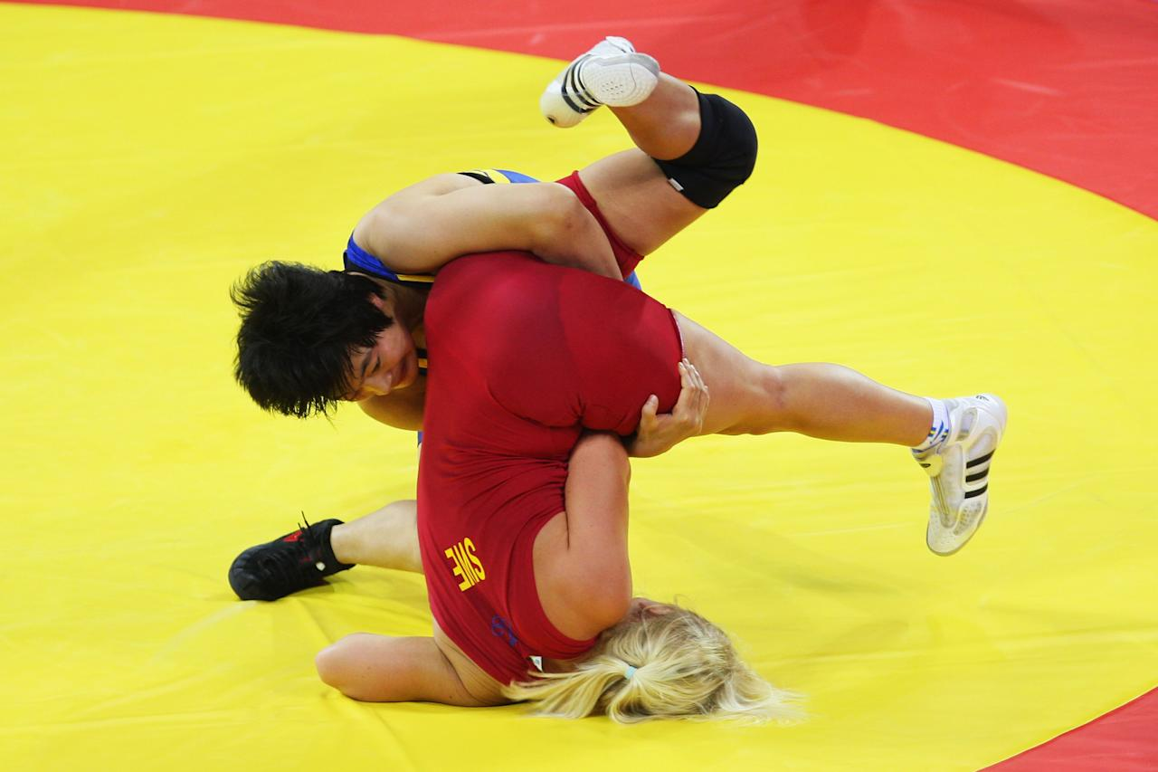 BEIJING - AUGUST 17:  Jenny Fransson (red) of Sweden competes against Wang Jiao (blue) of China in Women's FR 72 kg 1/8 Final held at the China Agriculture University Gymnasium on Day 9 of the Beijing 2008 Olympic Games on August 17, 2008 in Beijing, China.  (Photo by Phil Walter/Getty Images)