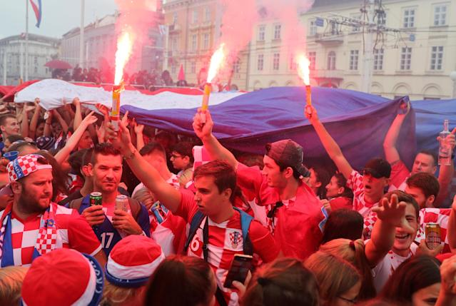 <p>Soccer Football – World Cup – Final – France v Croatia – Zagreb, Croatia – July 15, 2018 – Croatia's fans are seen before the broadcast of the match at the city's main square. REUTERS/Marko Djurica </p>