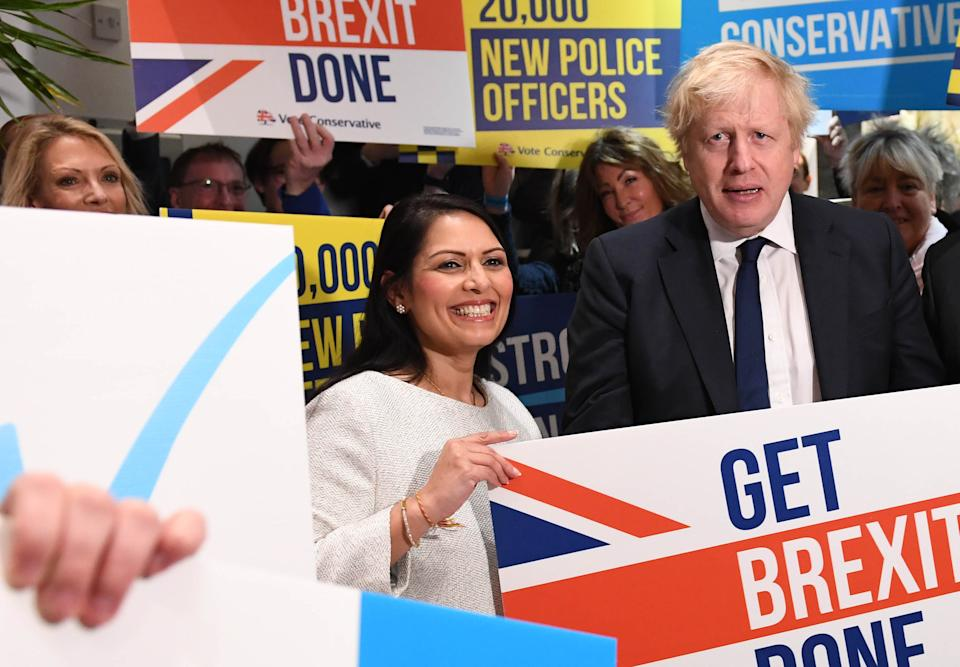 Prime Minister Boris Johnson and Home Secretary Priti Patel during a members rally held at property marketing agency, Think BDW, Colchester, while on the General Election campaign trail.