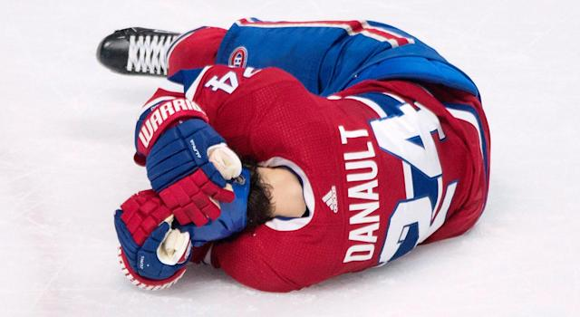 "Canadiens' <a class=""link rapid-noclick-resp"" href=""/nhl/players/5387/"" data-ylk=""slk:Phillip Danault"">Phillip Danault</a> clutches his head after getting hit by a <a class=""link rapid-noclick-resp"" href=""/nhl/players/1700/"" data-ylk=""slk:Zdeno Chara"">Zdeno Chara</a> slap shot. (Graham Hughes/CP)"