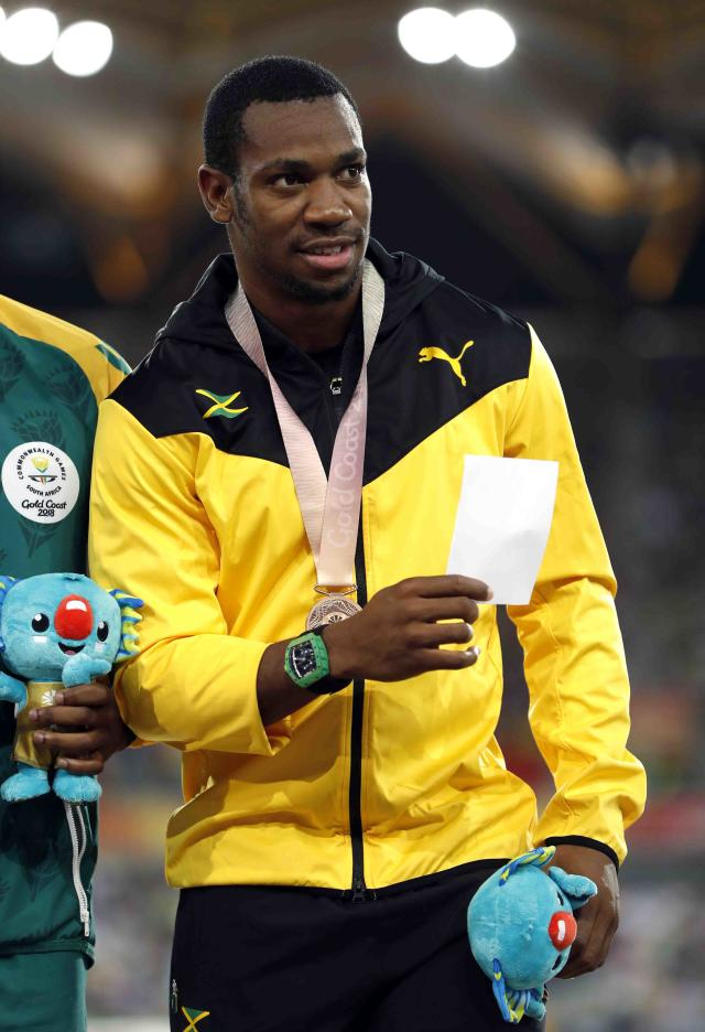 Athletics - Gold Coast 2018 Commonwealth Games - Men's 100m medal Ceremony - Carrara Stadium - Gold Coast, Australia - April 10, 2018. Bronze medalist Yohan Blake of Jamaica poses with medal. REUTERS/Paul Childs