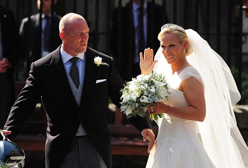 Mike Tindall and Zara Phillips step out of Canongate Kirk on Edinburgh's Royal Mile as man and wife (Photo by Owen Humphreys/PA Images via Getty Images)
