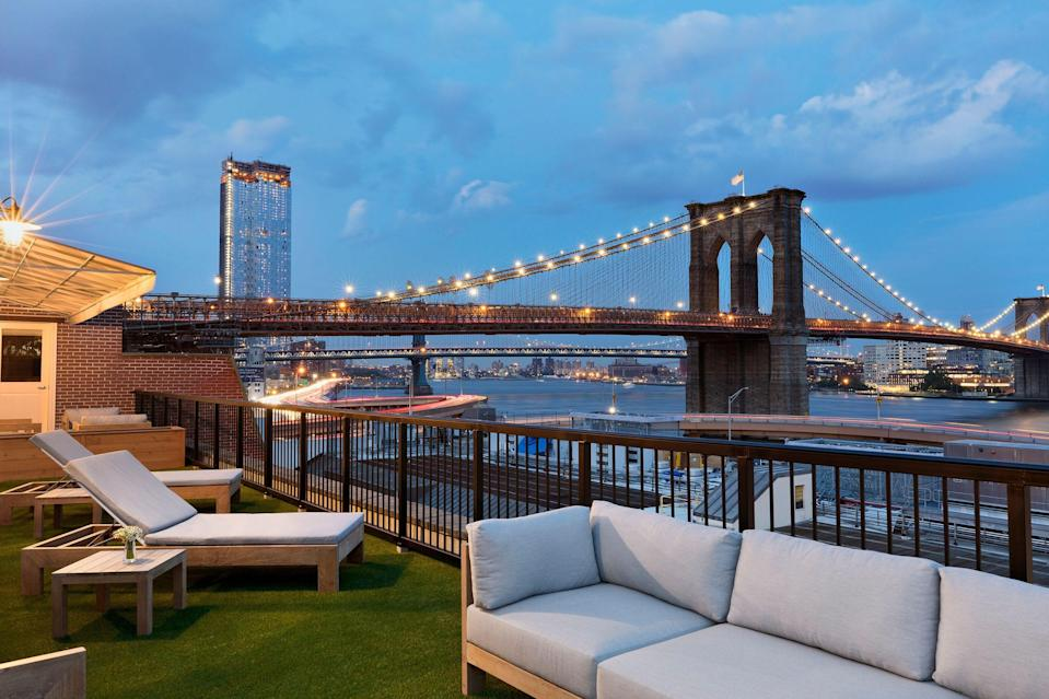 """<p>When it opened in 2018, this intimate, Leading Hotels of the World-member hotel heralded a new era for the historic Seaport district of downtown Manhattan, which has been undergoing a revitalization these last few years. Guests who check in to the <a href=""""mrchotels.com"""" rel=""""nofollow"""" data-ylk=""""slk:quiet haven"""" class=""""link rapid-noclick-resp"""">quiet haven</a> will find plenty of nods to Italy, from the imported linens to the menus at the Bellini restaurant. You'll never forget you're in New York, though—particularly when you can spy things like the <a href=""""https://www.cntraveler.com/activities/brooklyn/brooklyn-bridge-park?mbid=synd_yahoo_rss"""" rel=""""nofollow noopener"""" target=""""_blank"""" data-ylk=""""slk:Brooklyn Bridge"""" class=""""link rapid-noclick-resp"""">Brooklyn Bridge</a>, East River, and Financial District skyscrapers from the balconies of select rooms. To enjoy private outdoor space, book one of the Premier Peck Slip King Terrace or Premier Front Street King Terrace rooms, which are located on the sixth and seventh floor and have furnished terraces ranging between 147 to 185 square feet. Also on the sixth floor, the corner Signature Suite has a furnished, 721-square-foot wrap-around terrace, while the seventh-floor Mr. C Suite's wrap-around space is 558 square feet; both look out over the east side of the building, toward the Brooklyn Bridge and the water. </p> <p><strong>Book now</strong>: <a href=""""https://cna.st/affiliate-link/Fb1nPyBWjoYAPLtCDb1TMAUJPYbn2A2cqMthrEDLti4TkxMMyMeBUCVXftTm9Nv9bme2mhoi38i18QWGT1ooCbhrgLyA5gU9St4jPe6hNxYnhAJYuDTavLUiDUhzxpKBhD8soMDfvLLFXYmDTYwys84jEc7fs?cid=601b24333c02727115bd8dca"""" rel=""""nofollow noopener"""" target=""""_blank"""" data-ylk=""""slk:From $239 per night, expedia.com"""" class=""""link rapid-noclick-resp"""">From $239 per night, expedia.com</a></p>"""