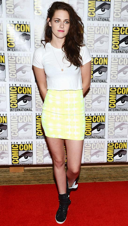 Twilight: Breaking Dawn 2: Kristen Stewart promotes the film at Comic-Con, in a rather short yellow skirt. We love! Copyright [Getty]