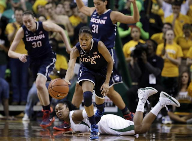 Connecticut guard Moriah Jefferson (4) comes away with a loose ball as Baylor guard Odyssey Sims, bottom, watches in the first half of an NCAA college basketball game, Monday, Jan. 13, 2014, in Waco, Texas. (AP Photo/Tony Gutierrez)