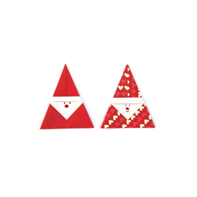 "<p>This easy Santa is a great place for newbies to start. Using solid or patterned paper with a contrasting backside, fold your Santas. Then give them faces with colored pencils. Make a bunch and stand them up along a windowsill or mantle, or use them to decorate gifts or other crafts.</p><p><em><a href=""https://www.gatheringbeauty.com/blog/how-to-make-easy-origami-christmas-trees-tutorial"" rel=""nofollow noopener"" target=""_blank"" data-ylk=""slk:Get the tutorial at Gathering Beauty»"" class=""link rapid-noclick-resp"">Get the tutorial at Gathering Beauty»</a></em></p>"