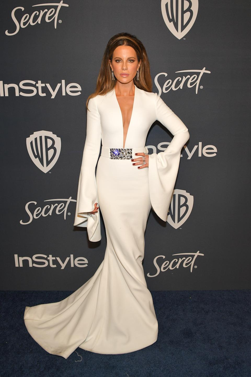 Wearing a white dress with fishtail and oversized sleeves. <em>[Photo: Getty]</em>