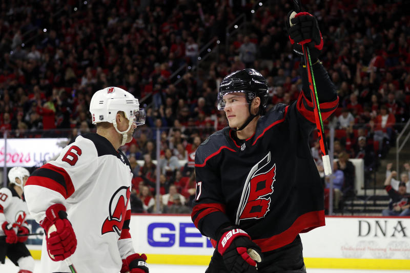 Carolina Hurricanes' Andrei Svechnikov (37), of Russia, celebrates his goal as he skates by New Jersey Devils' Andy Greene (6) during the second period of an NHL hockey game in Raleigh, N.C., Friday, Feb. 14, 2020. (AP Photo/Karl B DeBlaker)