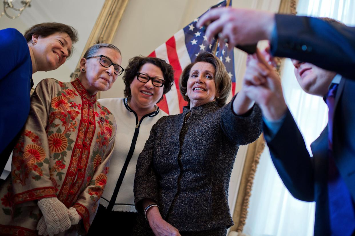 House Minority Leader Nancy Pelosi (D-Calif.) right, prepares to take a picture in her Capitol office with Supreme Court Justices, from left, Elena Kagan, Ruth Bader Ginsburg and Sonia Sotomayor, before a reception on March 18, 2015. The justices were in the Capitol to be honored at Pelosi's annual Women's History Month reception in Statuary Hall.