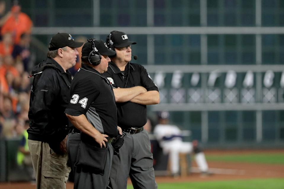 MLB umpires will be mic'd up in 2020 to explain replay rulings to fans. (Photo by Mike Ehrmann/Getty Images)