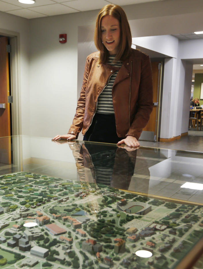 This photo taken Nov. 26, 2013 shows Jane Mahoney looking at a campus model at the student union on the University of Kansas campus in Lawrence, Kansas. About 320 colleges and universities offered tuition guarantees during the 2012-13 school year, according to an analysis of U.S. Department of Education data done by the National Association of Student Financial Aid Administrators. The schools represent about 6.7 percent of the nation's nearly 4,800 institutions where students receive federal financial aid.Tuition rates for freshmen are guaranteed for four years at Kansas. (AP Photo/Orlin Wagner)