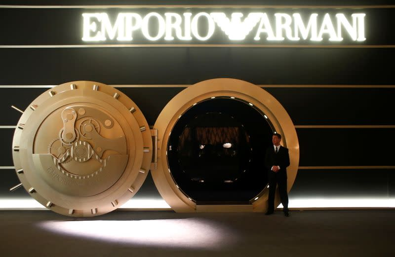 FILE PHOTO: A model stands in front of the exhibition stands of Emporio Armani at Baselworld fair in Basel
