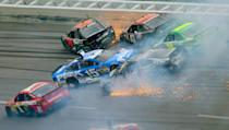 Drivers including Jamie McMurray (1), Clint Bowyer (15), Kurt Busch (78), Bobby Labonte, Ryan Newman (39 and David Stremme (30) collide in Turn 3 during the NASCAR Sprint Cup Series Aaron's 499 auto race at Talladega Superspeedway in Talladega, Ala., Sunday, May 5, 2013. (AP Photo/Greg McWilliams)