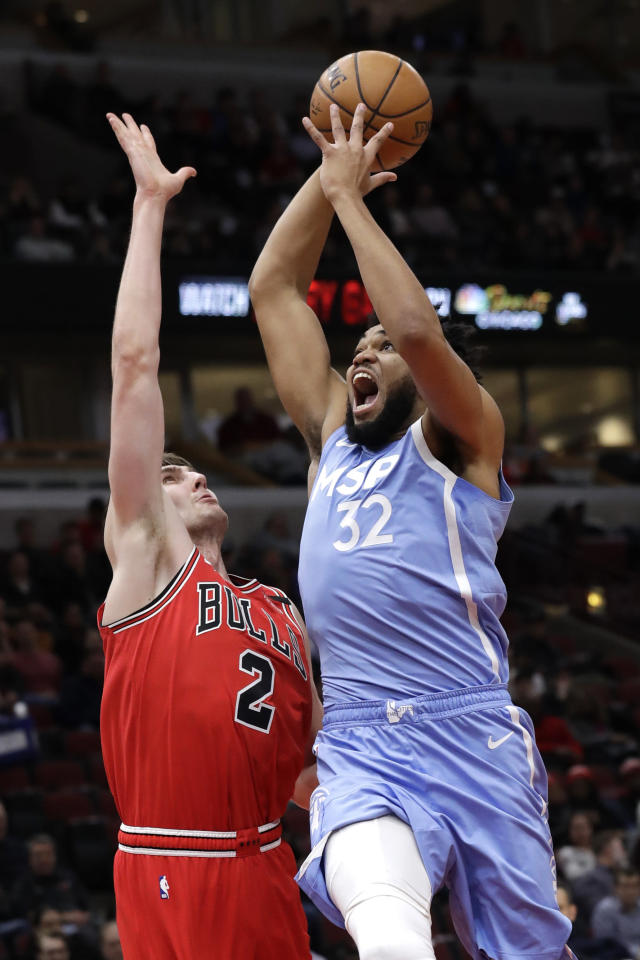 Minnesota Timberwolves center Karl-Anthony Towns, right, goes up for a shot against Chicago Bulls forward Luke Kornet during the first half of an NBA basketball game in Chicago, Wednesday, Jan. 22, 2020. (AP Photo/Nam Y. Huh)