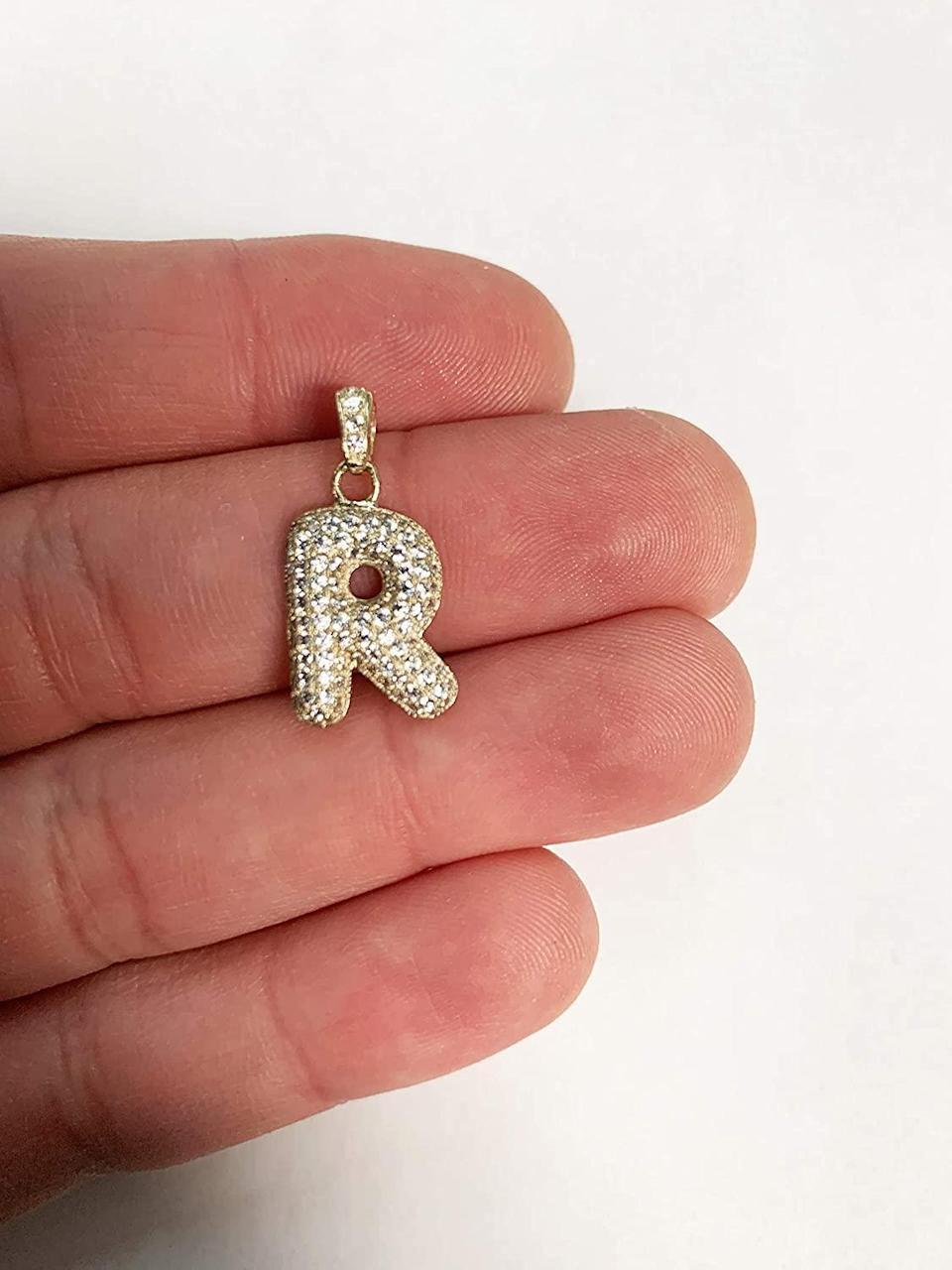 """<h3>Ice On Fire Solid Gold Initial Pendant<br></h3> <br>One of our favorite hacks for spending less coin on fine jewelry is to purchase a precious pendant and string it on an existing chain. Now that we've saved all that money, we're definitely splurging one or more of these delicious bubble-letter alphabet pendants — each is solid 10K gold studded with cubic zirconia.<br><br><em>Shop fine jewelry on <strong><a href=""""https://amzn.to/312Z4Am"""" rel=""""nofollow noopener"""" target=""""_blank"""" data-ylk=""""slk:Amazon"""" class=""""link rapid-noclick-resp"""">Amazon</a></strong></em><br><br><strong>Ice on Fire</strong> Solid Gold Bubble Initial Pendant, $, available at <a href=""""https://www.amazon.com/Ice-Fire-Jewelry-Available-Different/dp/B07ZG2C63B/ref=pd_d0_recs_v4_ac_6/138-1957692-6850243?th=1"""" rel=""""nofollow noopener"""" target=""""_blank"""" data-ylk=""""slk:Amazon"""" class=""""link rapid-noclick-resp"""">Amazon</a><br><br><br>"""