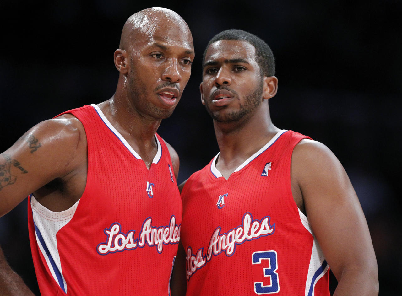Newly acquired Los Angeles Clippers players Chris Paul (R) and Chauncey Billups talk during their NBA preseason basketball game against the Los Angeles Lakers in Los Angeles, California December 19, 2011. REUTERS/Lucy Nicholson (UNITED STATES - Tags: SPORT BASKETBALL)