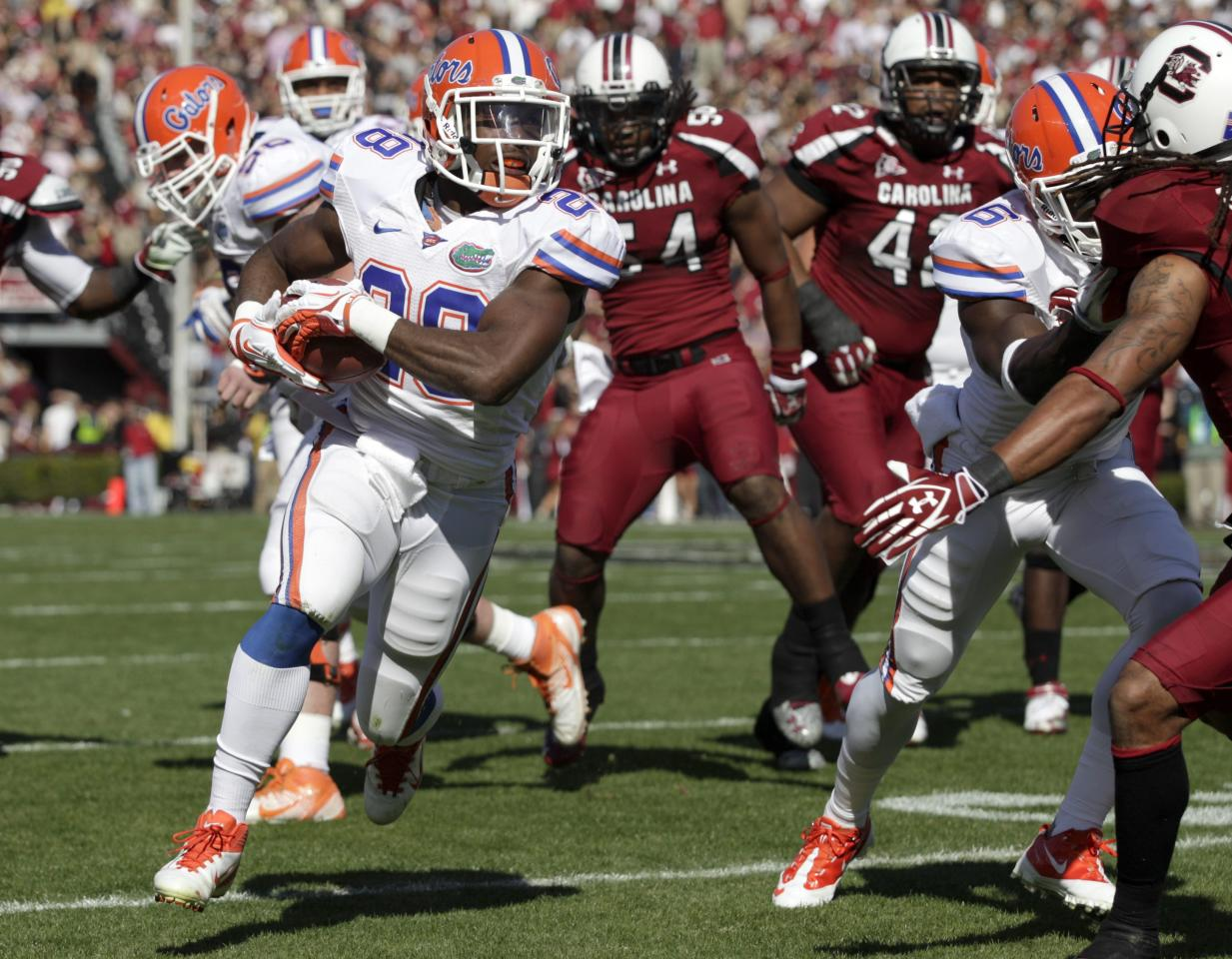 Florida running back Jeff Demps, left, finds a hole in the South Carolina defense as he picks up a first down during the second quarter of an NCAA college football game at Williams-Brice Stadium, in Columbia, S.C., Saturday, Nov. 12, 2011.  (AP Photo/Brett Flashnick)