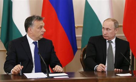 Russia's President Vladimir Putin and Hungary's Prime Minister Viktor Orban attend a meeting at the Novo-Ogaryovo state residence outside Moscow