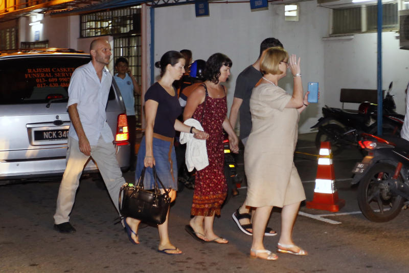 Family members of missing British girl Nora Anne Quoirin arrive at a hospital morgue in Seremban, Negeri Sembilan, Malaysia, Tuesday, Aug. 13, 2019. Malaysian police say the family of a missing 15-year-old London girl has positively identified a body found near the nature resort where she disappeared over a week ago. (AP Photo/Lai Seng Sin)