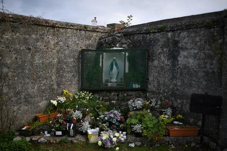 FILE PHOTO: A man is seen at the site of the Tuam babies graveyard where the bodies of 796 babies were uncovered at a former Catholic home in Tuam