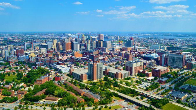 This photo was taken of Baltimore, MD while flying a helicopter at an altitude of 1000 feet above ground level and passing the city on June 12, 2017 while on a photo mission from a promotions company for twelve golfing resorts.