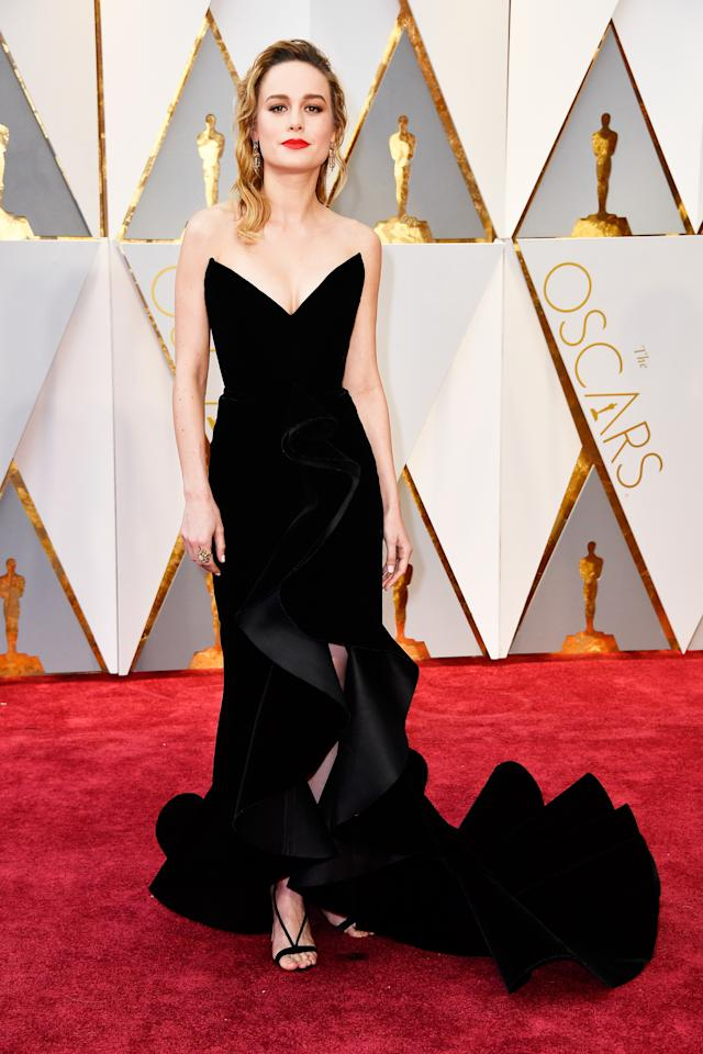 <p>In 2017, Brie Larson brought old school Hollywood glamour to the red carpet in her va-va-voom Oscar de la Renta dress. Complete with a ruffled train and dramatic V-neckline, the actress looked like the most glamorous Disney villain of all time. </p>