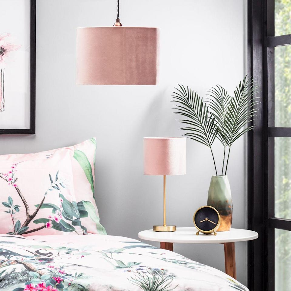 """<p>'Offering an alternative to white and wood effect, grey has been growing in popularity in bedroom furniture and offers a calming neutral base to build colour around,' says Megan Baker, Head of Design at <a href=""""https://www.myfittedbedroom.com/"""" rel=""""nofollow noopener"""" target=""""_blank"""" data-ylk=""""slk:My Fitted Bedroom"""" class=""""link rapid-noclick-resp"""">My Fitted Bedroom</a>.</p><p>'Using pink accents in the bedroom can give life and vibrancy to a more neutral backdrop.'</p><p>• Velvet 30cm Easyfit Shade, Pink and Brass, £22, <a href=""""https://go.redirectingat.com?id=127X1599956&url=https%3A%2F%2Fwww.bhs.com%2Fvelvet-30cm-shade-pink-brass.html&sref=https%3A%2F%2Fwww.housebeautiful.com%2Fuk%2Fdecorate%2Fbedroom%2Fg37103497%2Fpink-grey-bedroom%2F"""" rel=""""nofollow noopener"""" target=""""_blank"""" data-ylk=""""slk:BHS"""" class=""""link rapid-noclick-resp"""">BHS</a></p>"""