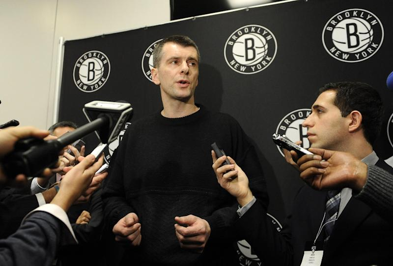 Brooklyn Nets principal owner Mikhail Prokhorov  speaks to the media concerning the firing of head coach Avery Johnson.  Prokhorov spoke at half time of an NBA basketball game against the Charlotte Bobcats on Friday, Dec., 28, 2012 at Barclays Center in New York. (AP Photo/Kathy Kmonicek)