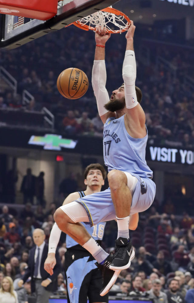 Memphis Grizzlies' Jonas Valanciunas (17) dunks against the Cleveland Cavaliers in the first half of an NBA basketball game, Friday, Dec. 20, 2019, in Cleveland. (AP Photo/Tony Dejak)