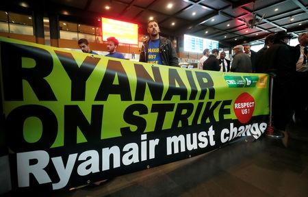 FILE PHOTO: Belgian Ryanair pilots and crew members take part in a protest during a wider European strike at the airline to protest slow progress in negotiating a collective labour agreement, at Brussels South Charleroi Airport, Belgium September 28, 2018. REUTERS/Yves Herman/File Photo