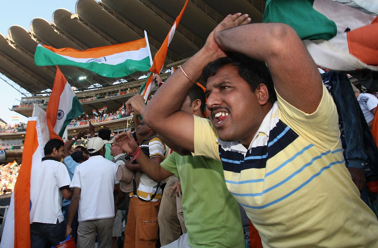 JOHANNESBURG, SOUTH AFRICA - SEPTEMBER 24:  Indian fans celebrate as India move towards victory during the Twenty20 Championship Final match between Pakistan and India at The Wanderers Stadium on September 24, 2007 in Johannesburg, South Africa.  (Photo by Hamish Blair/Getty Images)