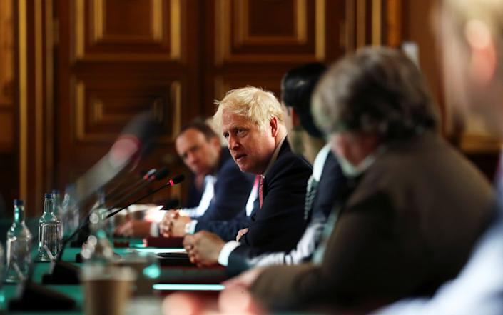 Boris Johnson was challenged by his Cabinet ministers over the plans - GETTY IMAGES