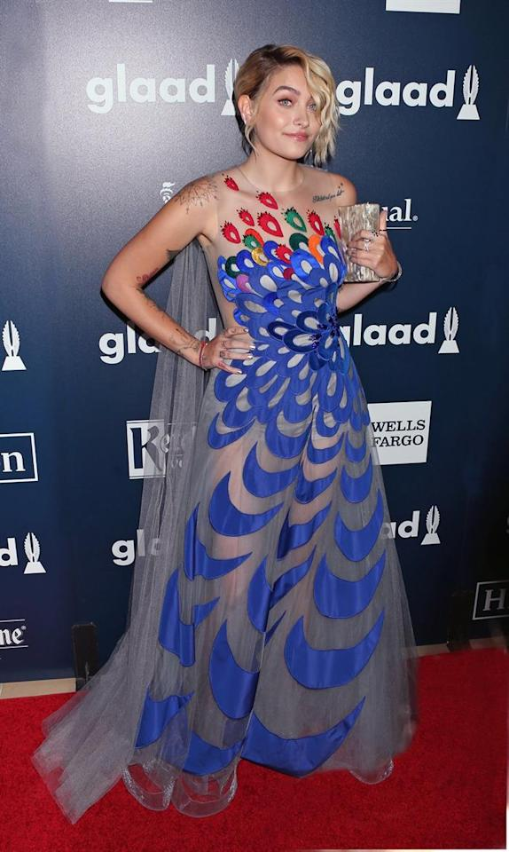 <div>Paris took a major risk in this peacock-printed Yanina Couture gown but it really paid off.<br /><i>[Photo: EFE]</i> </div>