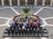 In this handout photo released by Mexico's Presidential Press Office, leaders from Latin America and the Caribbean pose for a group photo in a courtyard of the National Palace during the Community of Latin American and Caribbean States, or CELAC summit, in Mexico City, Saturday, Sept. 18, 2021. (Mexico's Presidential Press Office via AP)