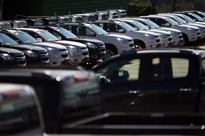 Vehicles sit parked in a lot at a General Motors vehicle factory in Sao Jose dos Campos