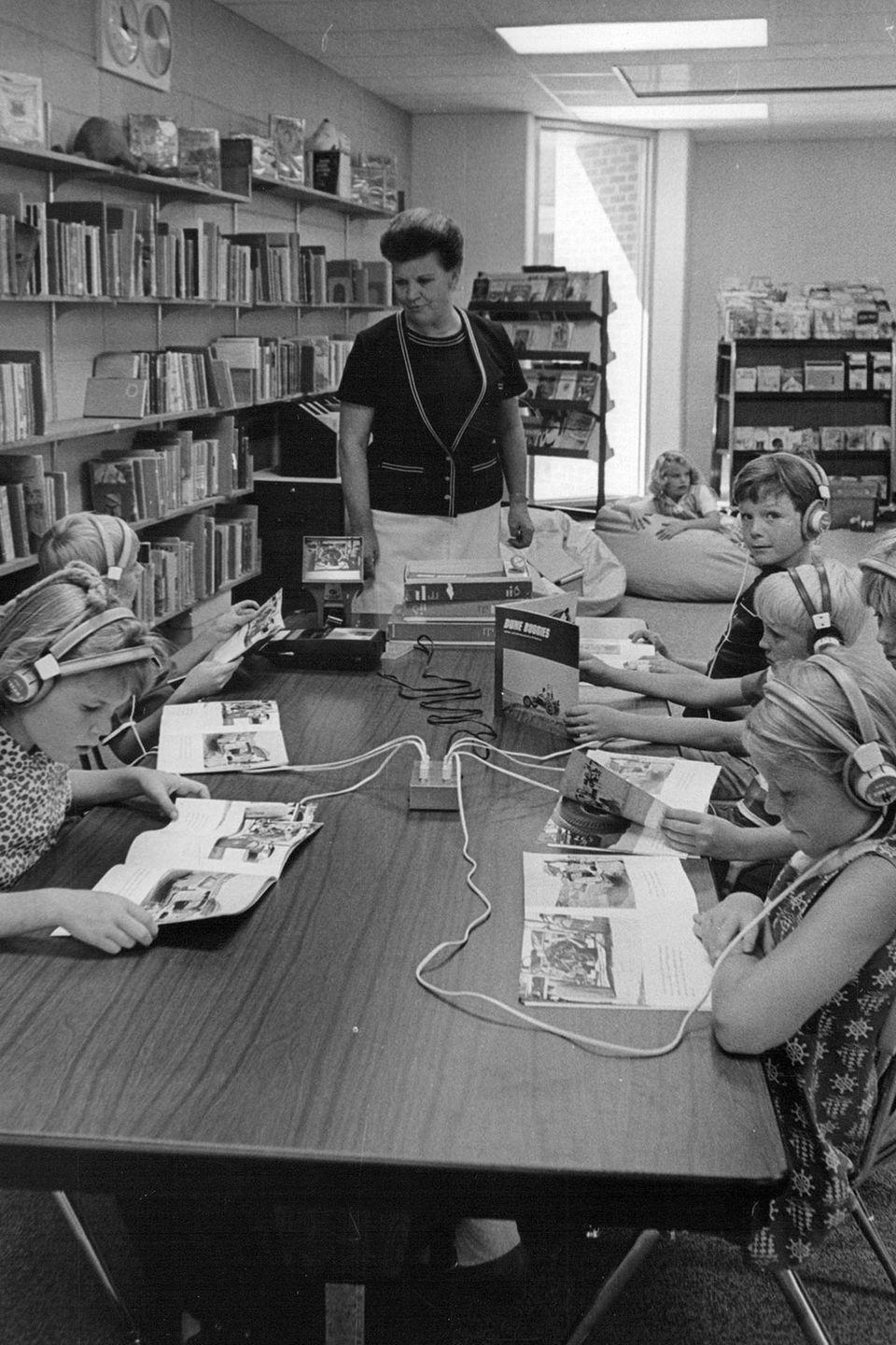 <p>A teacher watches over her students as they receive lessons from the library media center. </p>