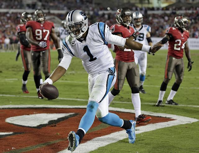 Carolina Panthers quarterback Cam Newton (1) celebrates after scoring on a 6-yard touchdown run against the Tampa Bay Buccaneers during the third quarter of an NFL football game on Thursday, Oct. 24, 2013, in Tampa, Fla. (AP Photo/Chris O'Meara)