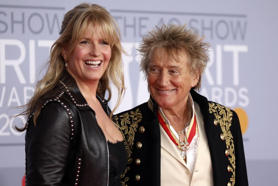 Rod Stewart and Penny Lancaster pose for photographers upon arrival at Brit Awards 2020 in London, Tuesday, Feb. 18, 2020.(Photo by Vianney Le Caer/Invision/AP)