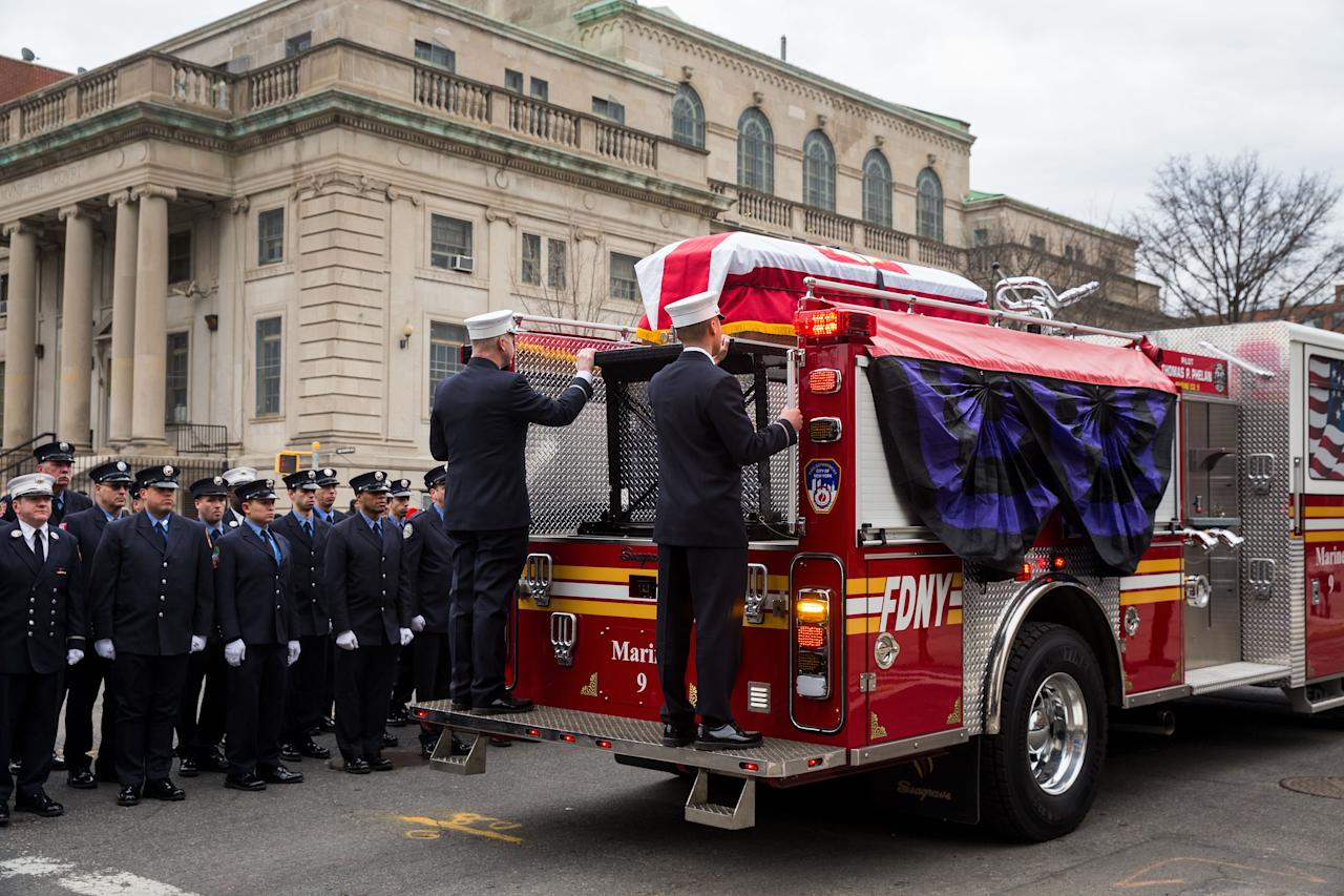 <p>Members of the New York City fire department (FDNY) escort the casket of firefighter Thomas Phelan to St. Michael's Church in the Sunset Park neighborhood March 20, 2018 in the Brooklyn borough of New York City. Phelan worked as a Statue of Liberty ferry boat captain, helping to evacuate thousands of stranded citizens from Lower Manhattan during the 9/11 attacks. He joined the FDNY in 2003. Phelan, 45, died March 16 of cancer believed to be related to his exposure to the toxic fumes around the Ground Zero site. (Photo by Drew Angerer/Getty Images) </p>
