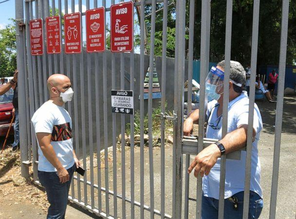PHOTO: An electoral official, right, tells a voter that the ballots haven't arrived at a voting center in Carolina, Puerto Rico, Aug. 9, 2020. (Danica Coto/AP)
