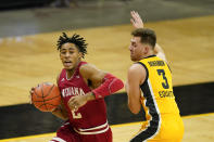 Indiana guard Armaan Franklin drives to the basket past Iowa guard Jordan Bohannon, right, during the first half of an NCAA college basketball game, Thursday, Jan. 21, 2021, in Iowa City, Iowa. (AP Photo/Charlie Neibergall)