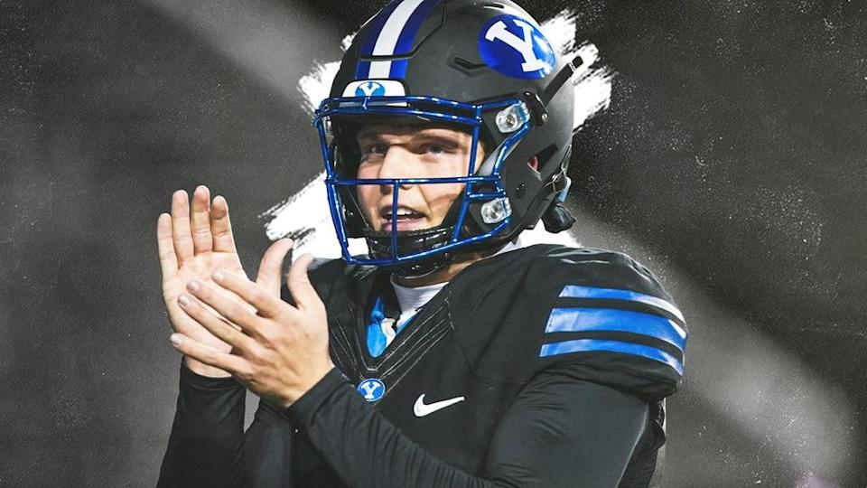 Zach Wilson treated image black BYU jersey clapping hands