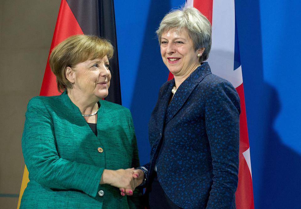 Angela Merkel shakes hands with Theresa May (Getty Images)