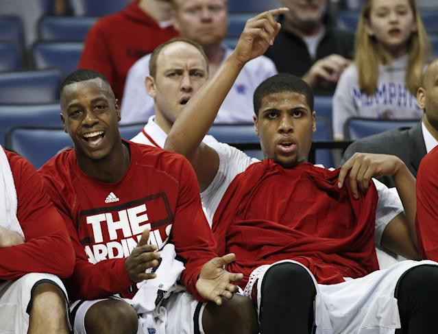 Louisville's Chris Jones, left, and Wayne Blackshear, right, watch from the bench in the final minutes of their 92-31 win over Rutgers in an NCAA college basketball game during the quarterfinals of the American Athletic Conference tournament Thursday, March 13, 2014, in Memphis, Tenn. (AP Photo/Mark Humphrey)